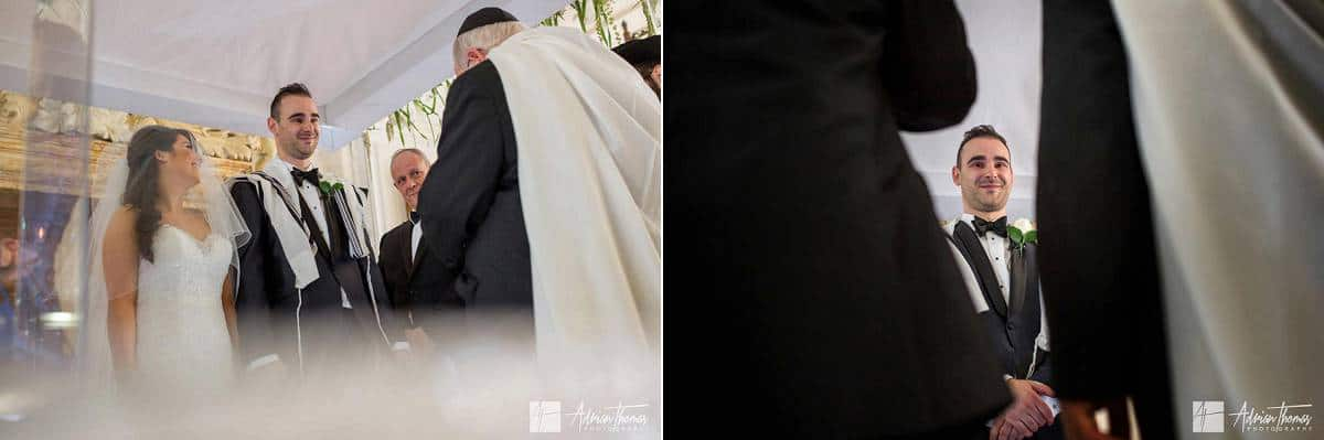 Bride laughing with groom at the Chuppah.