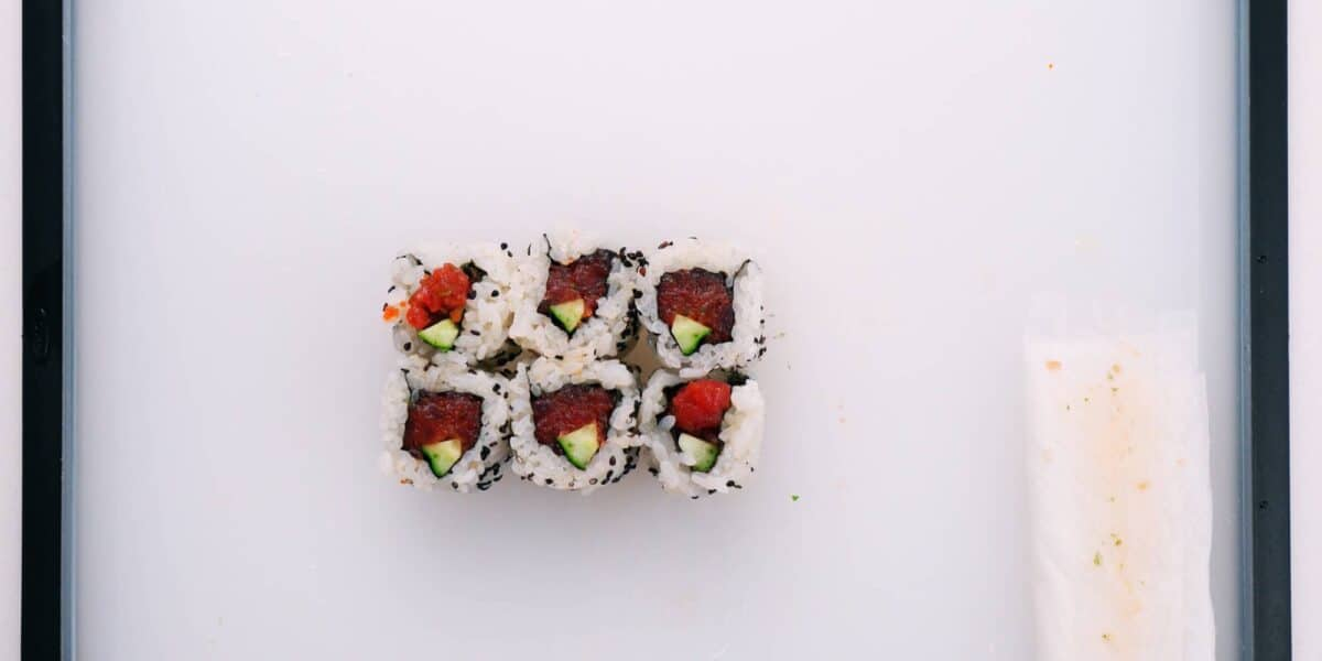 Flip the spicy tuna roll so the cut ends are facing up.