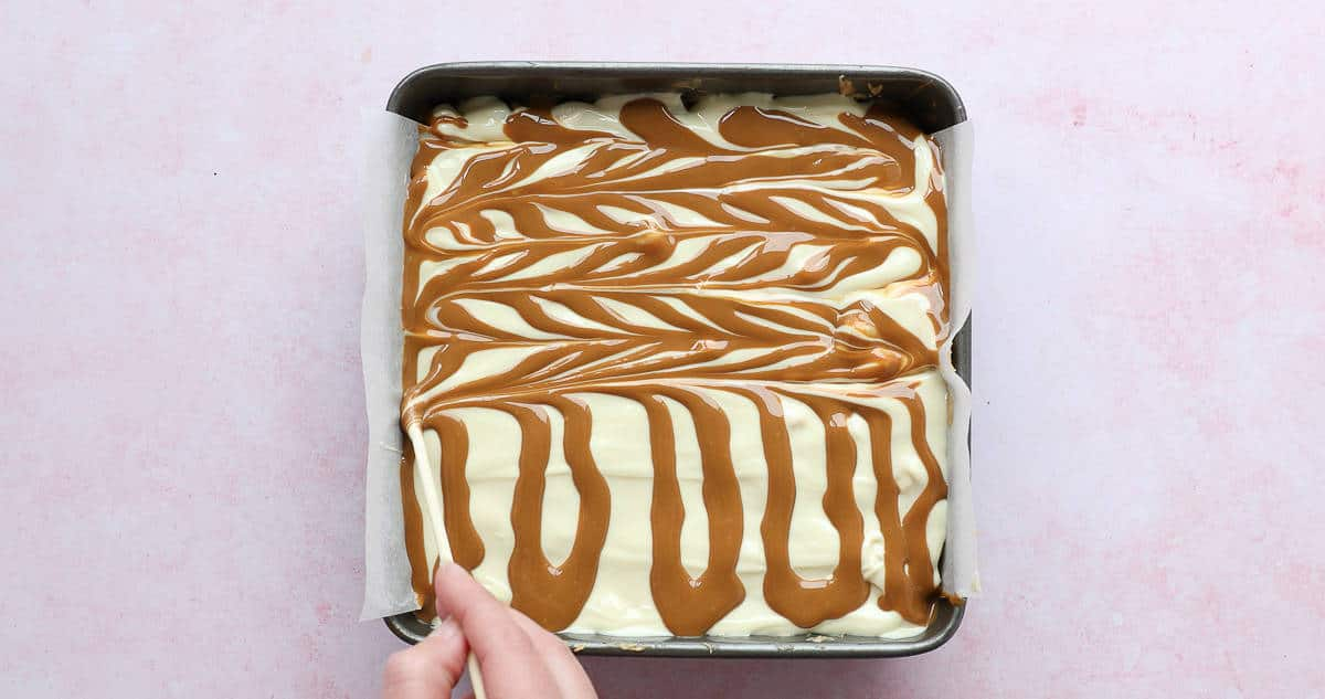 Swirling Biscoff spread into white chocolate.