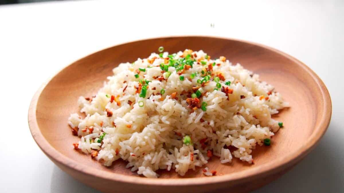 Sinangag or Filipino Garlic Fried Rice served in a wooden plate.