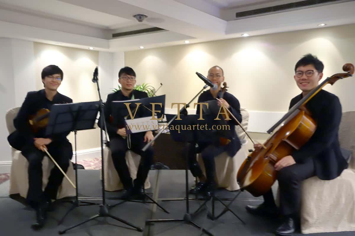 Live String Quartet playing background music for wedding at Marina Mandarin