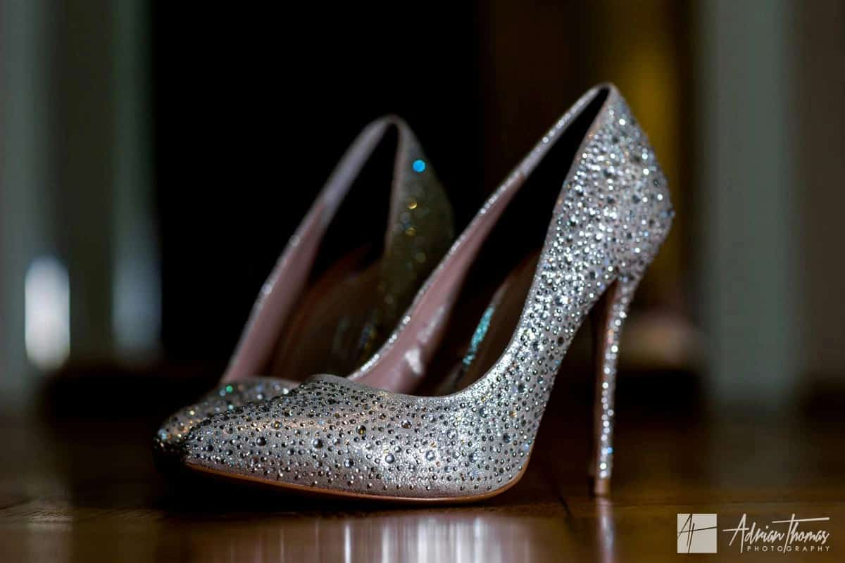 Brides silver and sparkling wedding shoes.