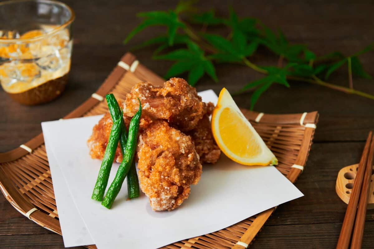Tatsutaage (Japanese Fried Chicken) is marinated in ginger, soy sauce, and sake before being coated in potato starch and fried until crisp on the outside and juicy in the center.