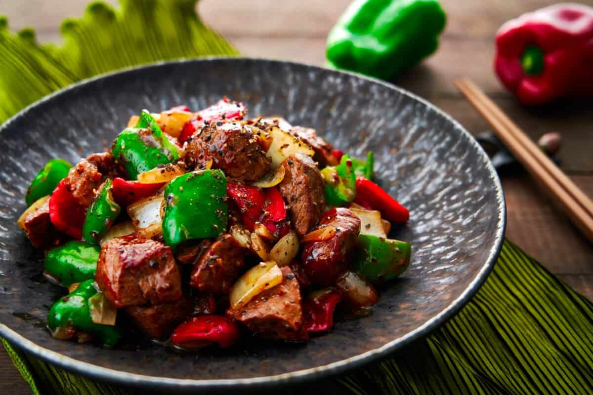 Black Pepper Beef is a classic Chinese stir-fry made with beef, onions, and peppers.