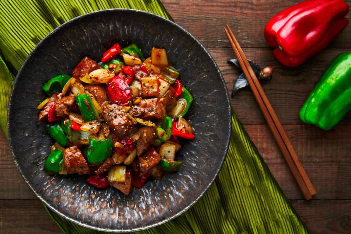 Tender, juicy cubes of steak stir-fried with onions, peppers, and Chinese black pepper sauce.