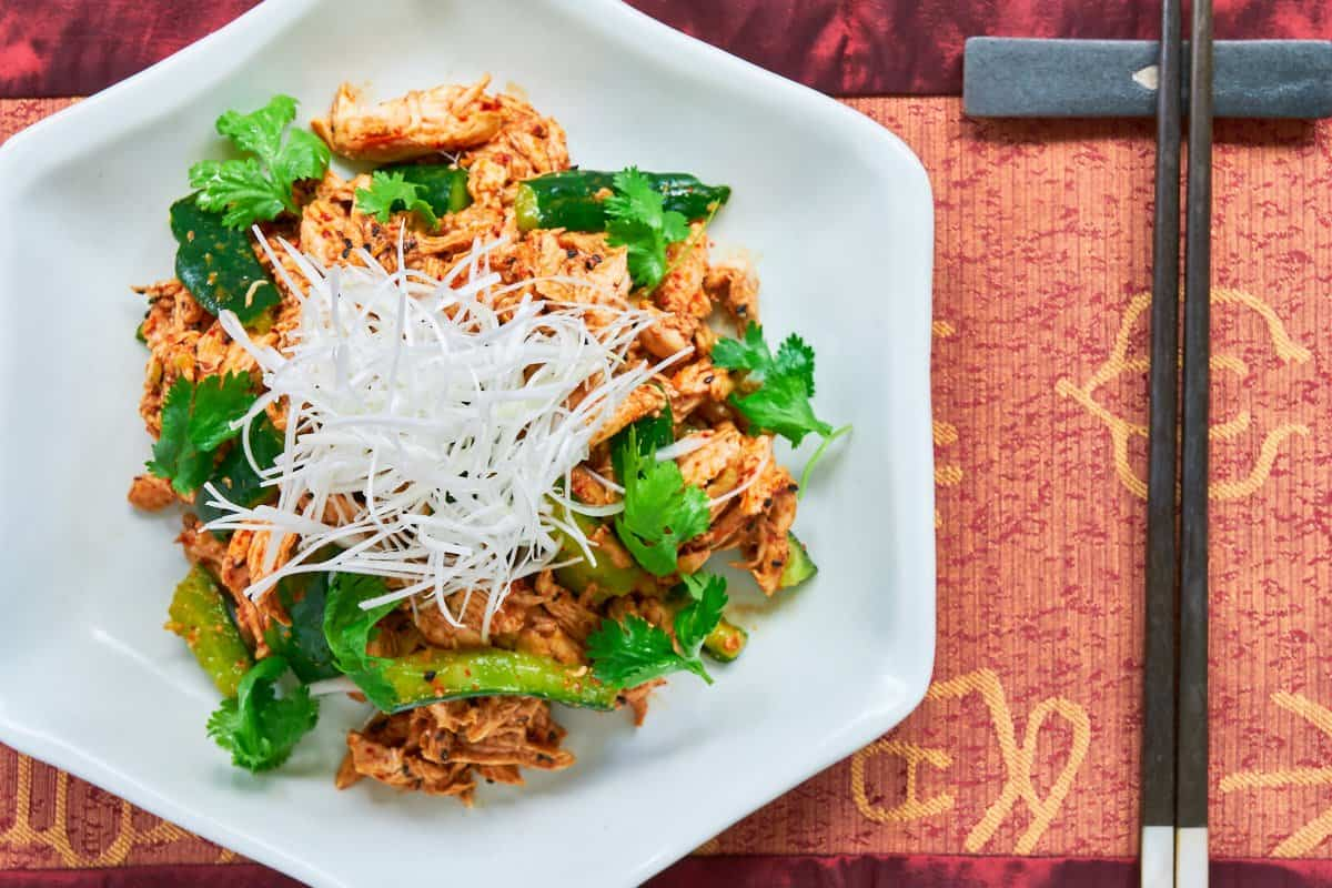 With tender poached chicken and crunchy cucumbers dressed in a fiery chili sesame sauce, my easy take on Bang Bang Chicken is simply scrumptious.