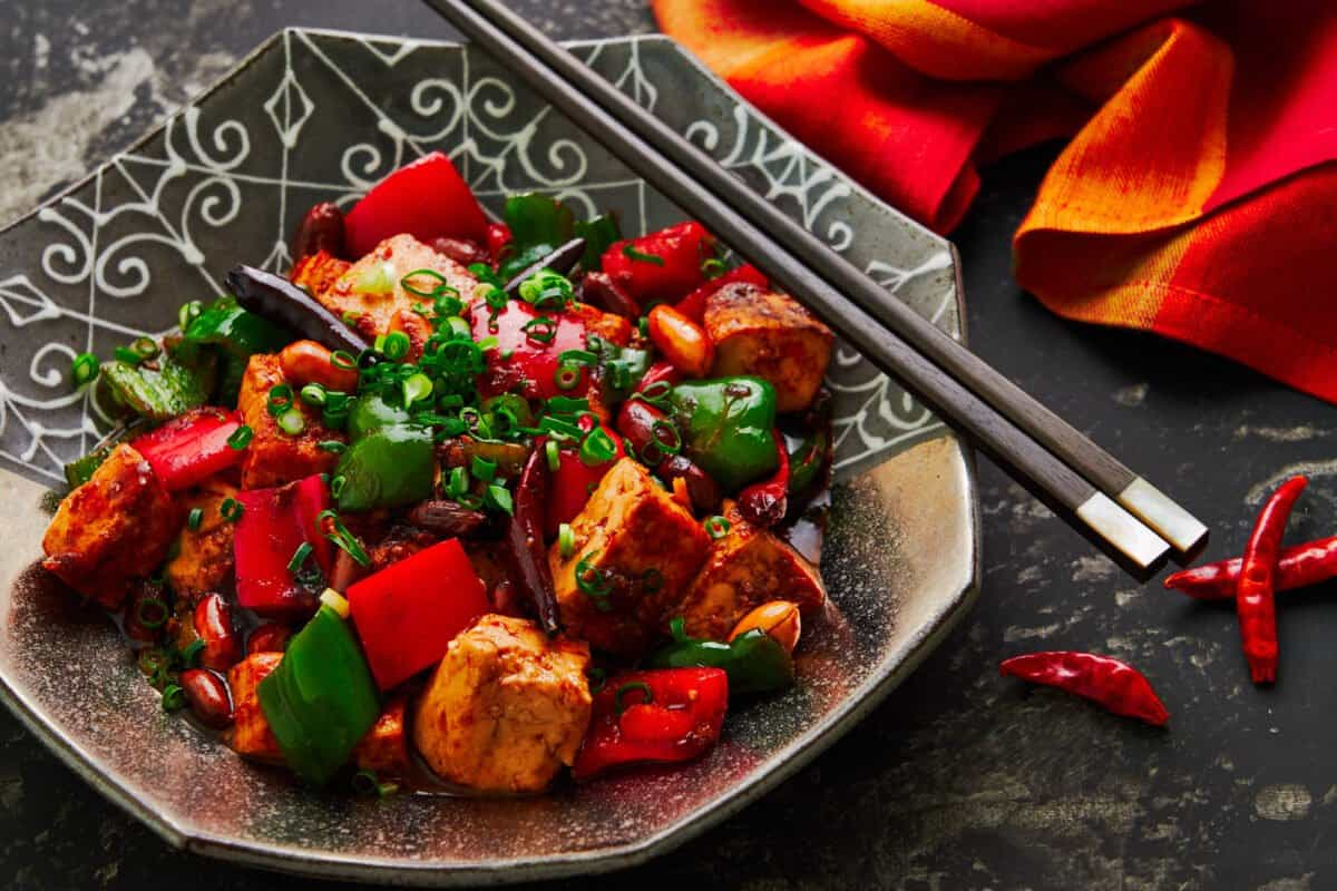 With meaty chunks of savory marinated tofu stir-fried with peanuts and peppers, this plant-based Kung Pao Tofu is loaded with contrasting tastes and textures that will keep you going back for more.