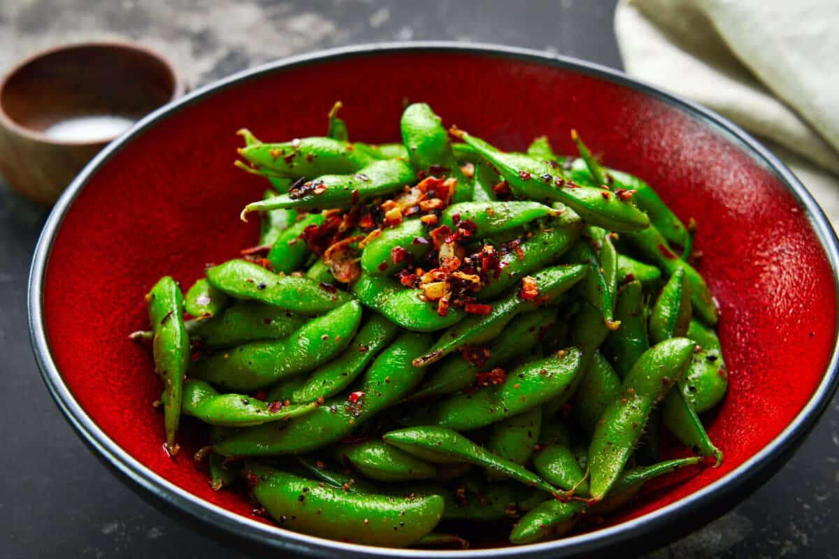 A fragrant trio of garlic, black pepper, and chili peppers turns this ordinary bowl of edamame into something extraordinary.