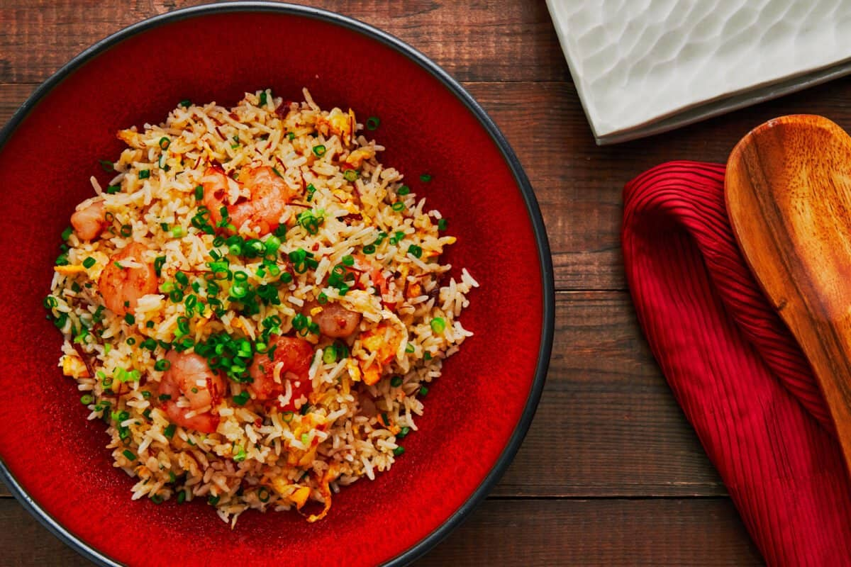 The best shrimp and egg fried rice in a red ceramic bowl.