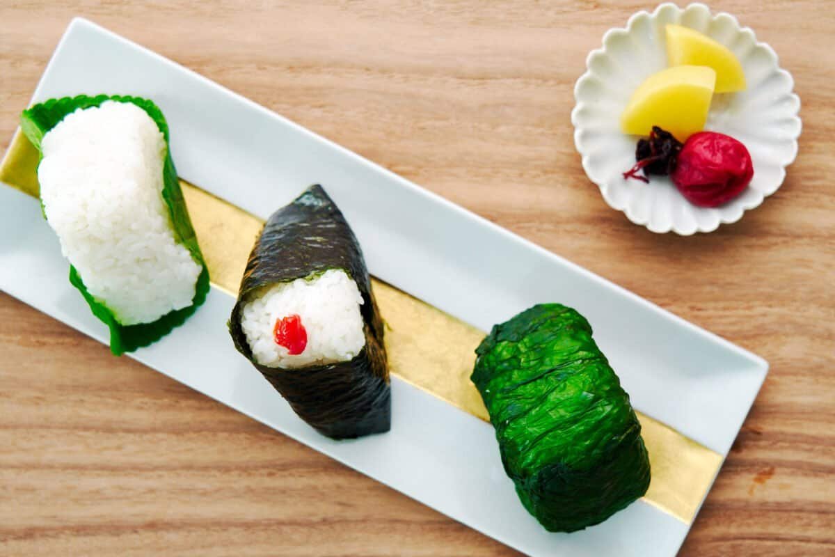 Three styles of Japanese Rice Ball: Tuna Mayo Onigiri, Umeboshi Onigiri, and Maze Gohan Onigiri.