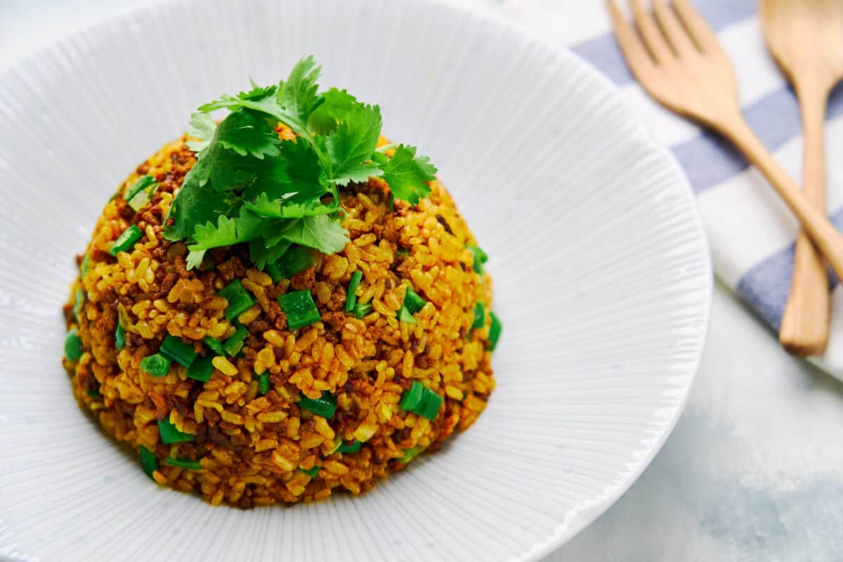 Japanese-style fried rice (yakimeshi) with ground beef, caramelized onions, and curry powder.