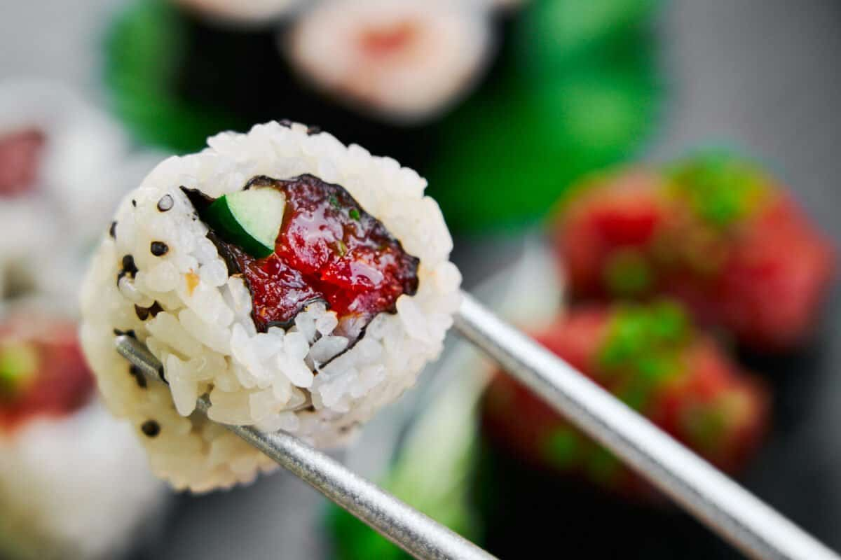 Easy spicy tuna roll recipe with cucumber and black sesame seeds.