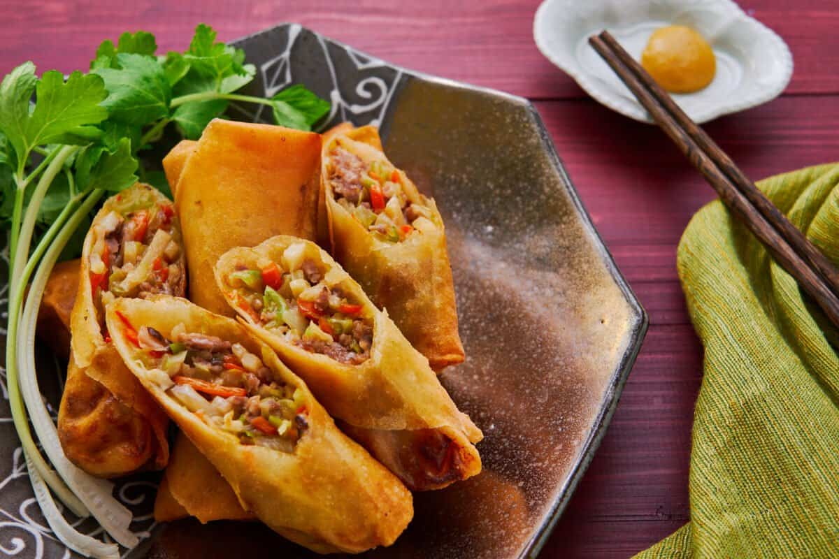 Japanese-style spring rolls, or harumaki, are filled with meat, veggies, mushrooms, and a savory sauce.