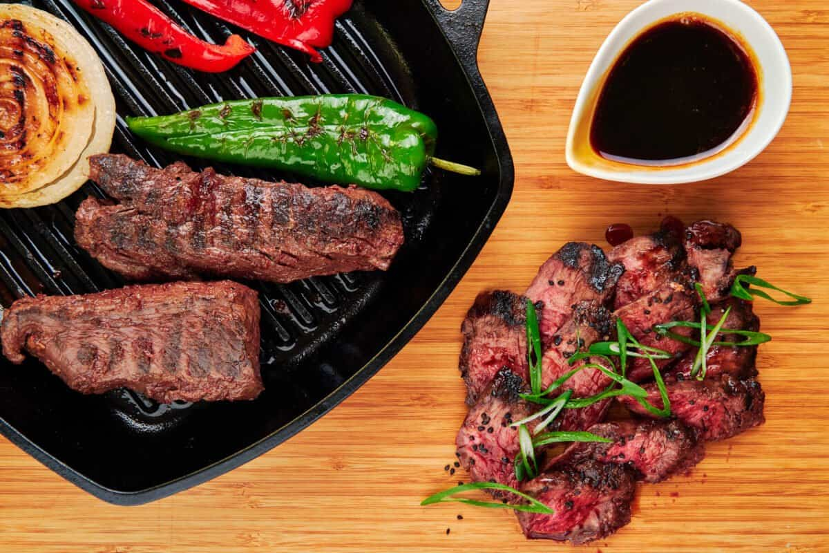 Hanger steak teriyaki grilled on a grill pan with Japanese teriyaki sauce.