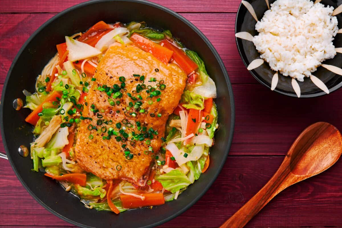 Tender salmon glazed with miso butter steamed atop a bed of cabbage, carrots, onions and mushroom.