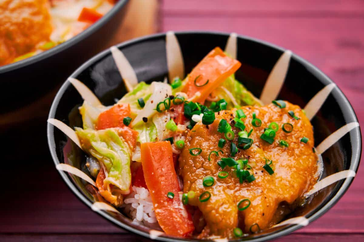 Miso Butter Salmon served on a bowl of rice.