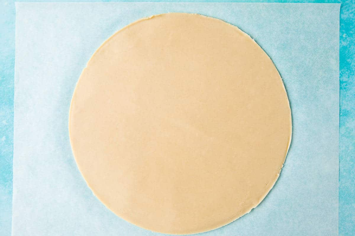 A circle of unbaked shortbread.