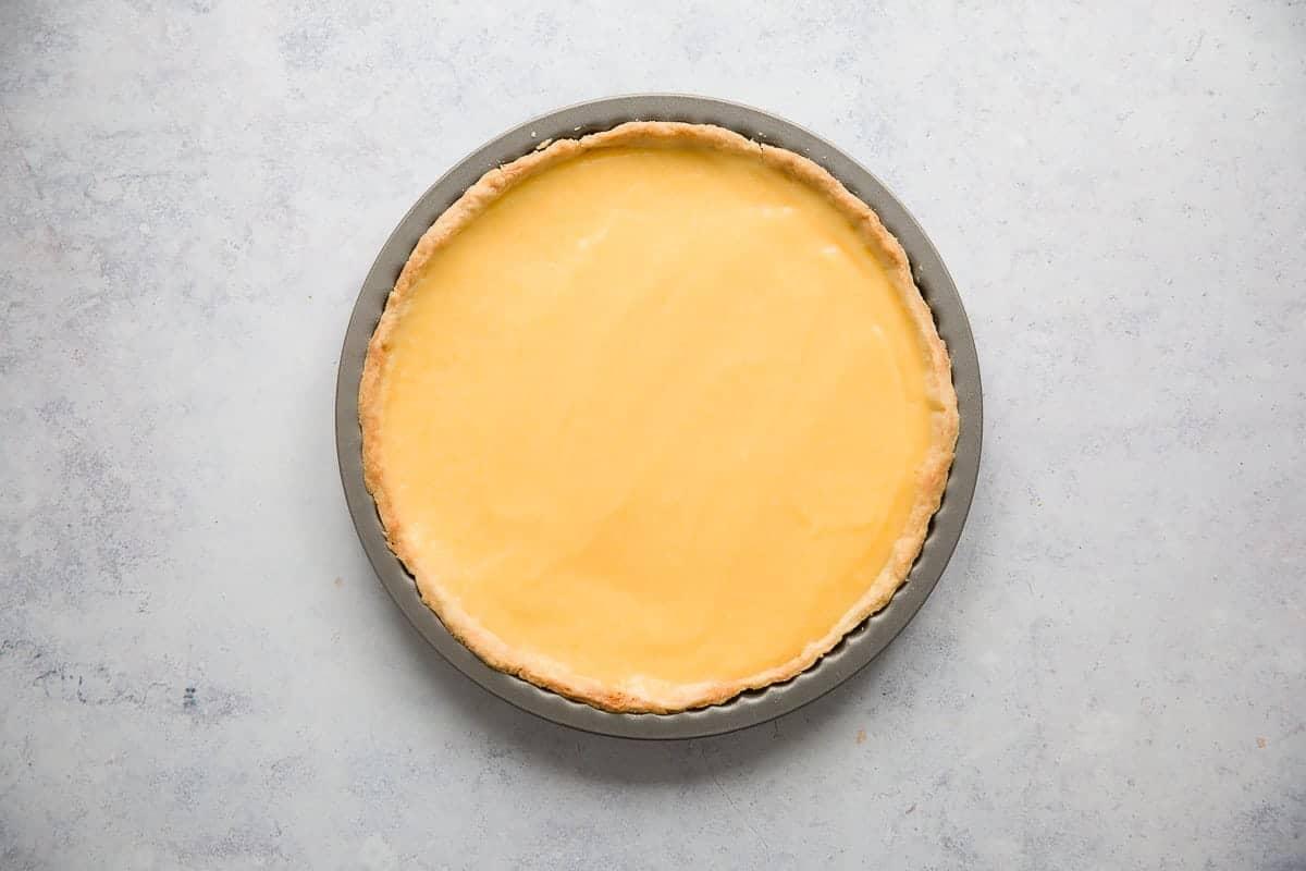 Lemon curd inside a pastry shell.