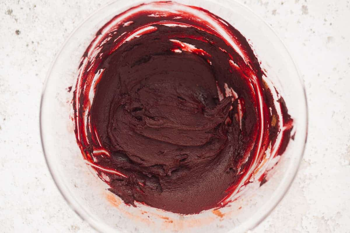A red paste made from gel food colouring, water, cocoa powder and vanilla bean paste.