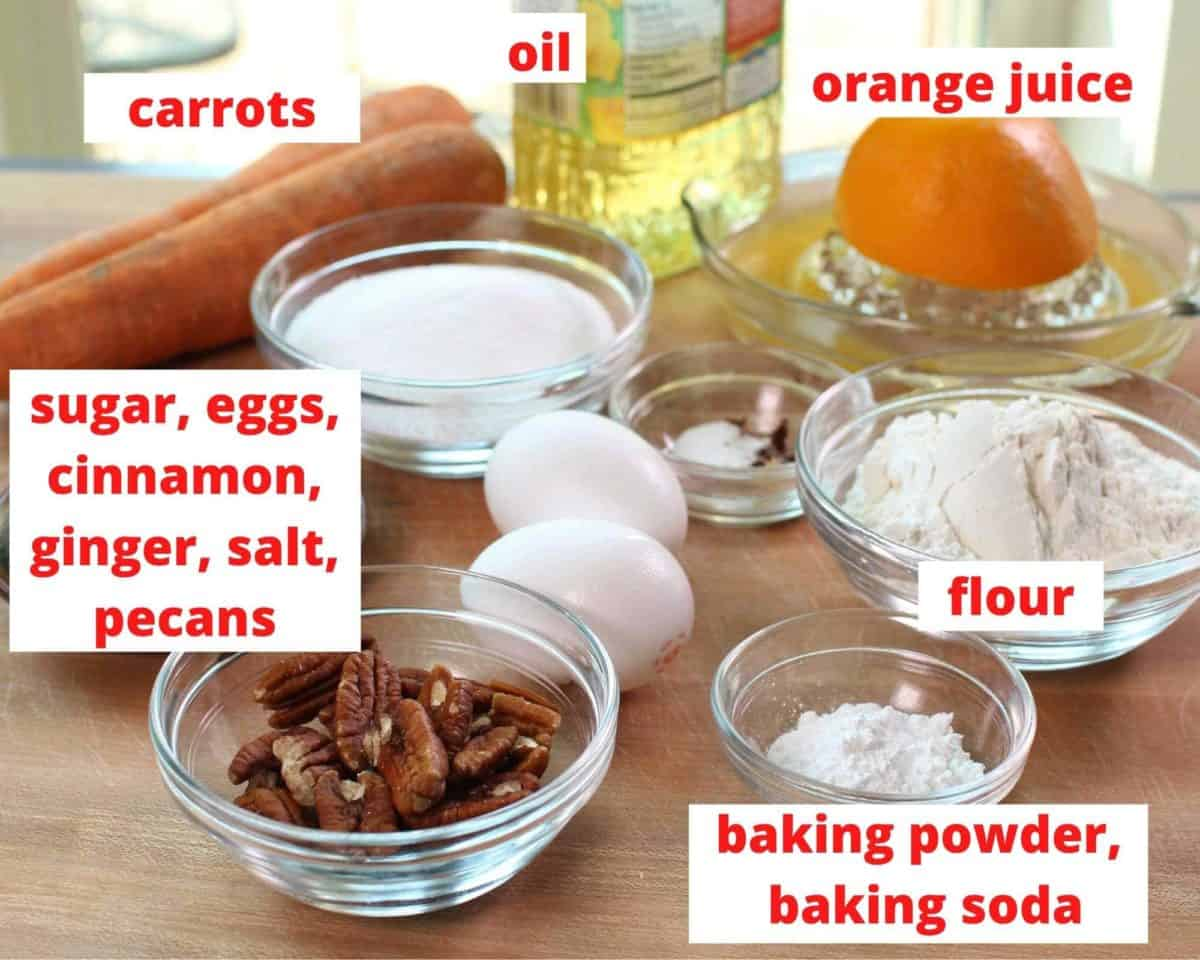 the ingredients in a carrot cake labeled and on a brown table.