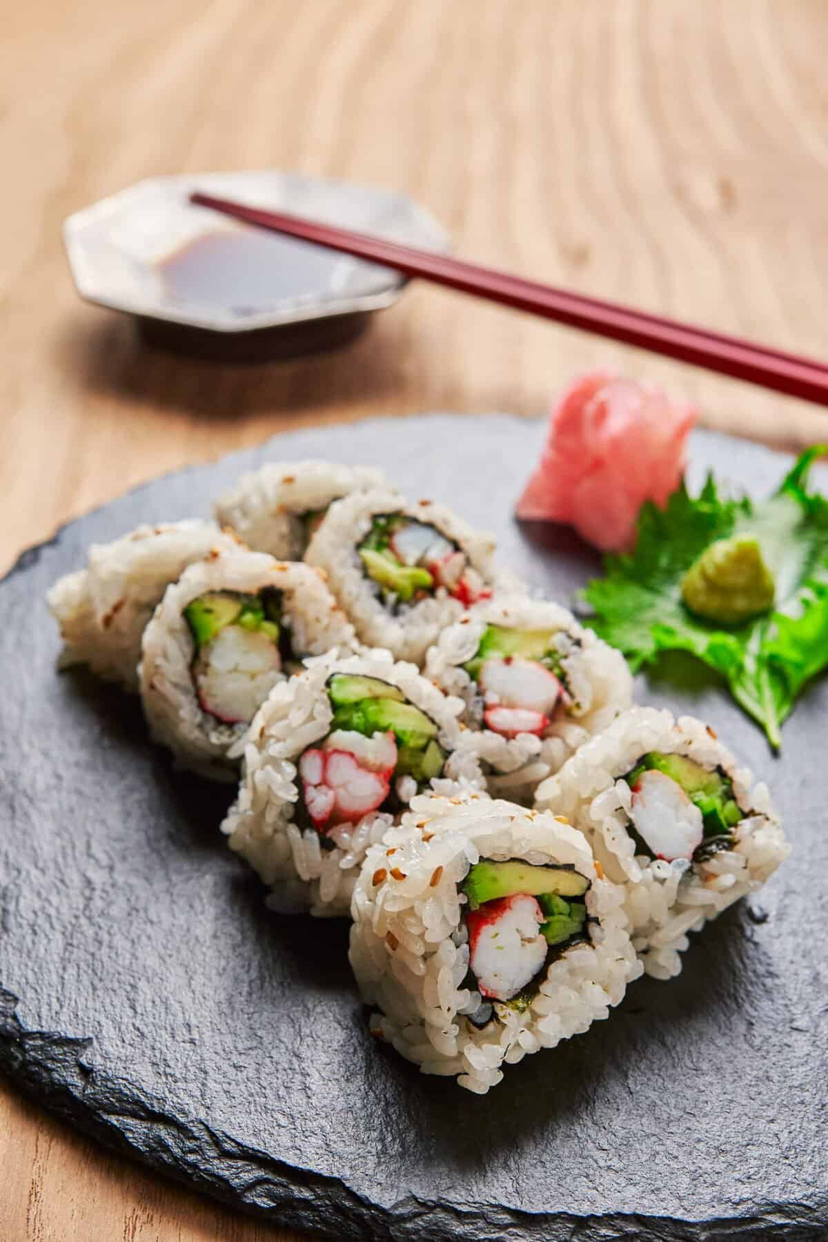 Here's how to make California Rolls at home like a pro. All the techniques you need to make the rice and roll the roll.