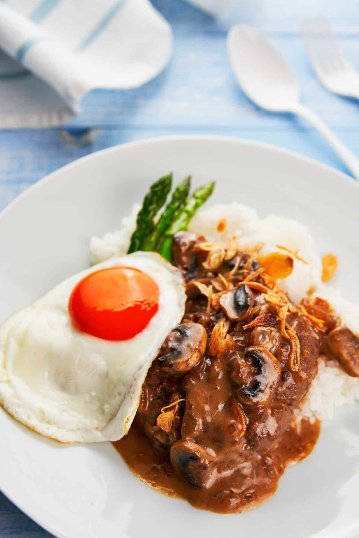 With tender seasoned hamburger patties smothered in pan-gravy, topped with a fried egg and crispy fried onions, Loco Moco is a mouthwatering Hawaiian classic that's easy to make and satisfying.