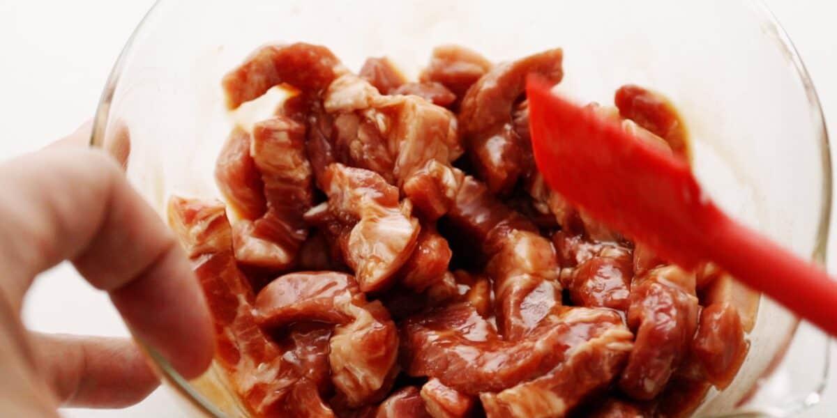 Marinating pork for making Chop Suey.