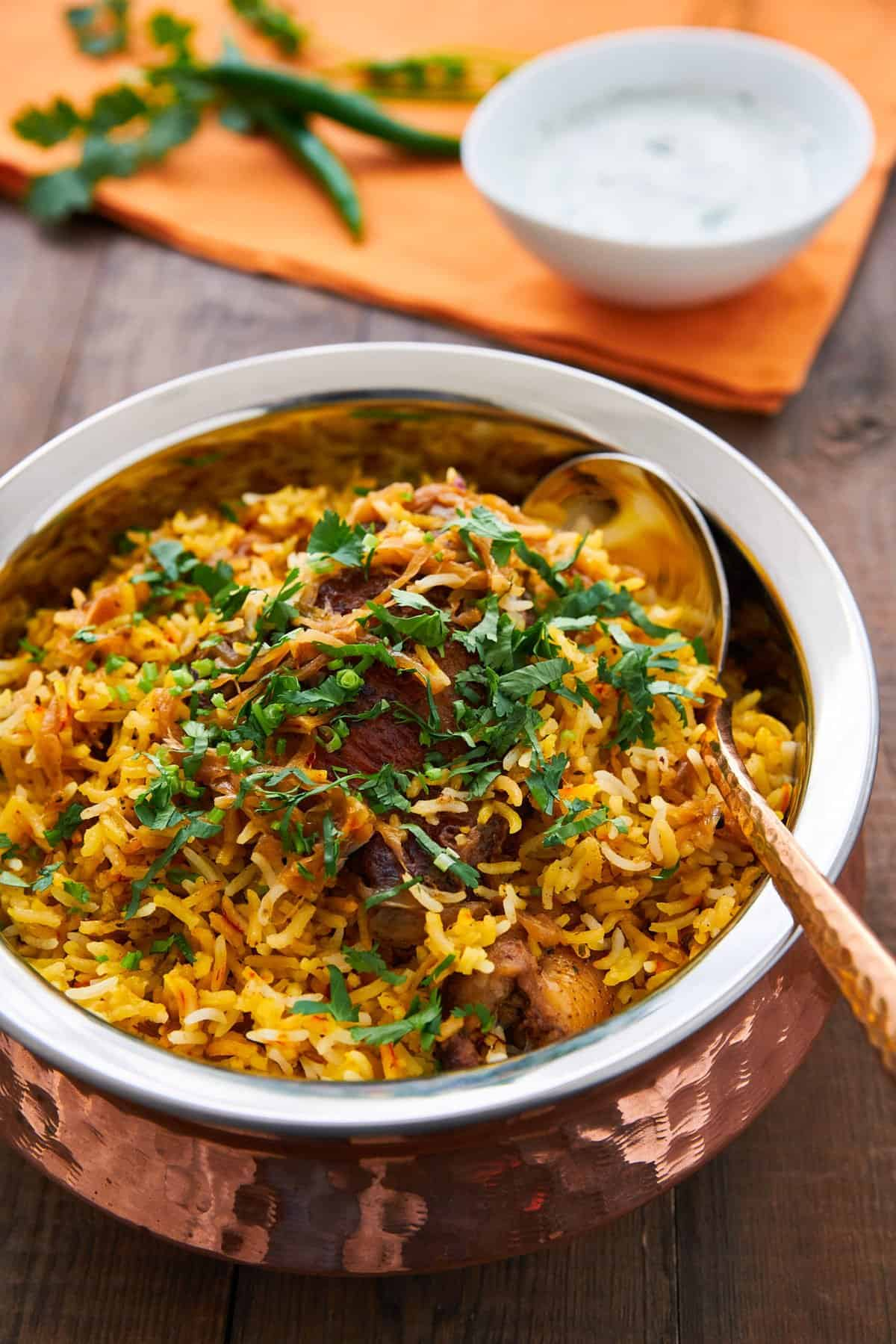Chicken Biryani is a delciious savory rice dish loaded with spicy marinated chicken, caramelized onions, and flavorful saffron rice.