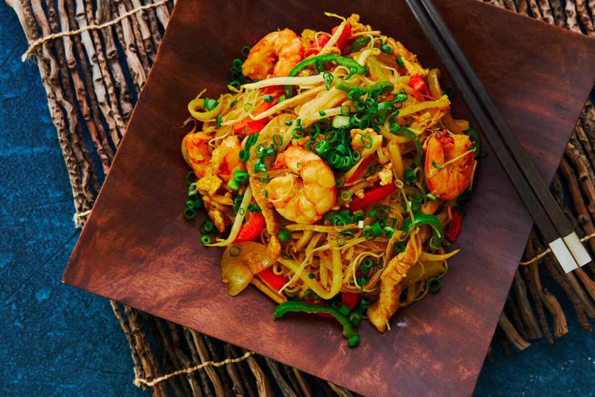 """A Chinese-American classic, these """"Singapore"""" Noodles are loaded with shrimp pork and vegetables, stir-fried with curry-flavored rice noodles."""