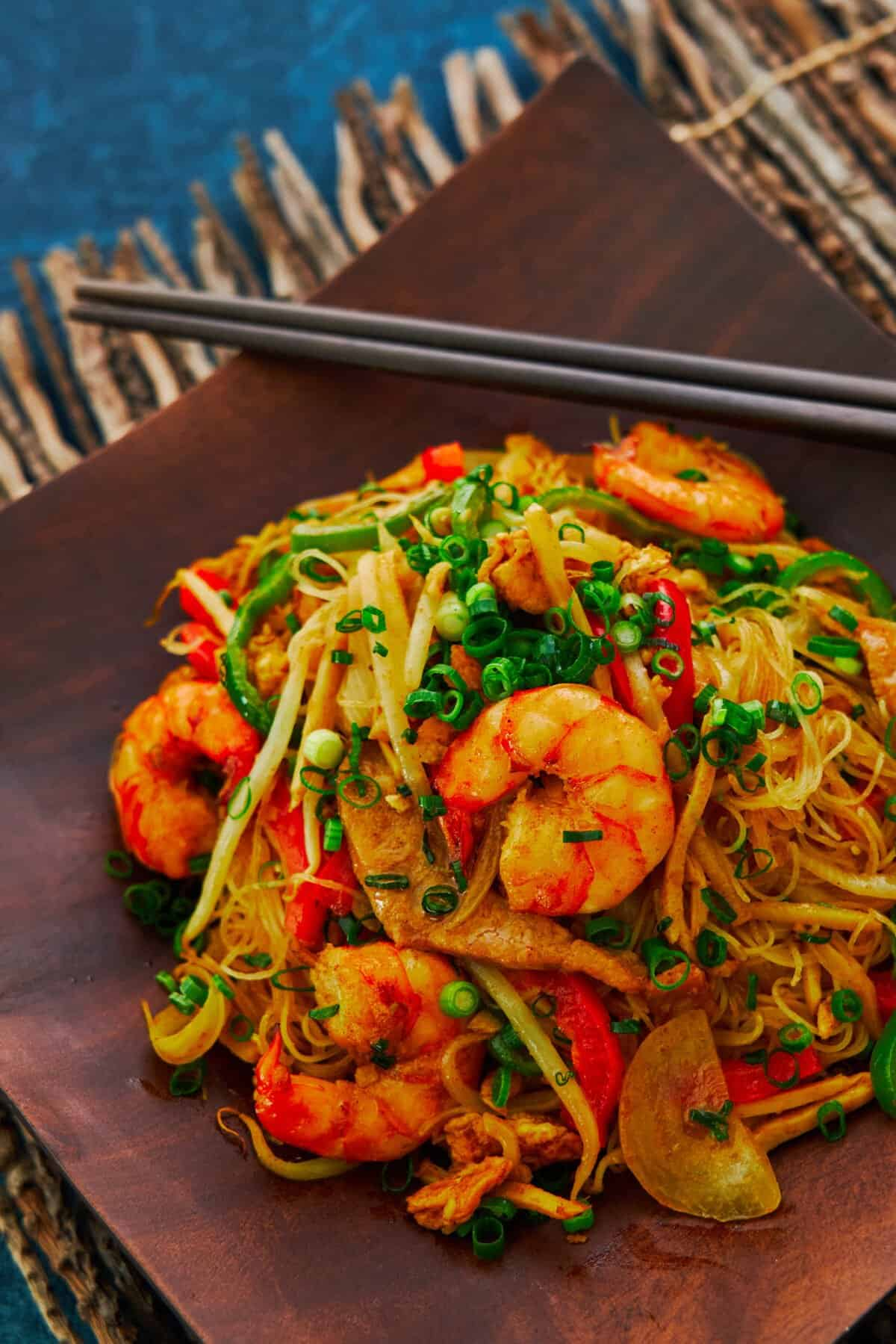 """It may not be from Singapore, but this """"Singapore"""" Noodles recipe makes a delicious stir-fry that's loaded with savory shrimp and crisp veggies."""