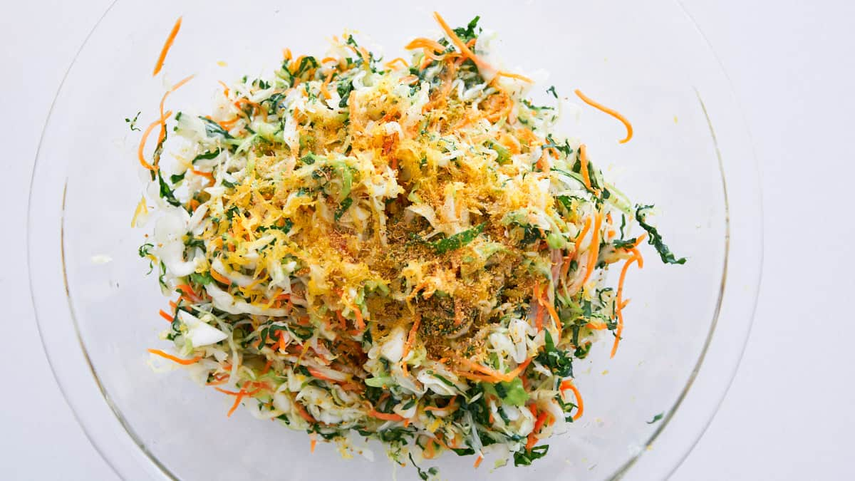 Fennel pollen and lemon dressing on cabbage, carrot and kale coleslaw.
