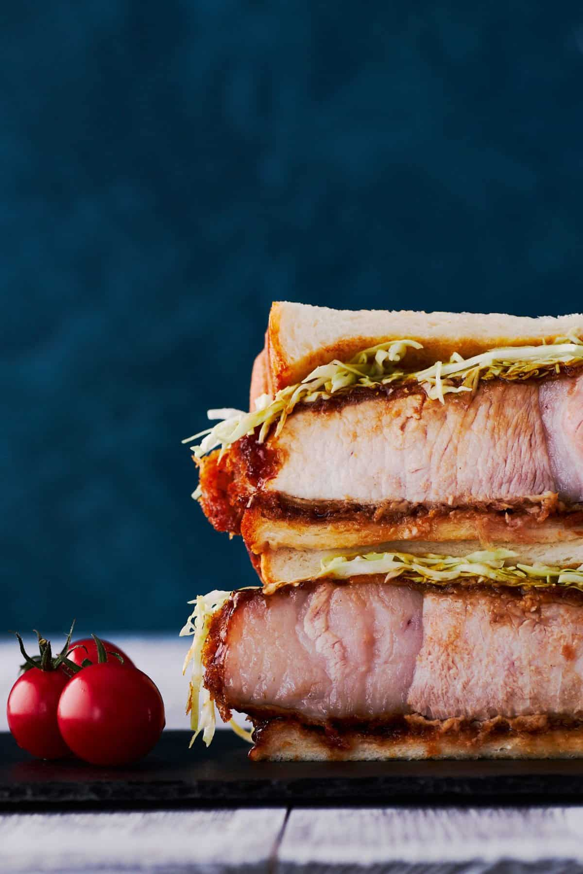With a thick juicy fried pork cutlet doused in a spiced fruit sauce, stuffed between two slices of fluffy Japanese sandwich bread, Katsu Sandwiches are so good that people are paying hundreds of dollars for them. This easy Katsu Sando recipe will make your stomach smile without breaking the bank.