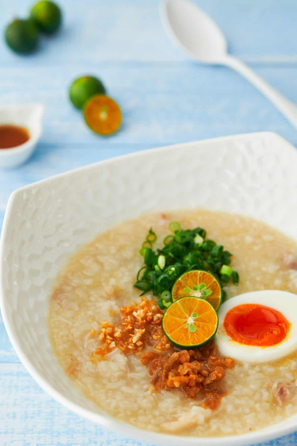 Arroz Caldo is a creamy chicken and ginger rice porridge with a mouthwatering array of contrasting condiments to go on top. The perfect way to add some warmth and sunshine to a wintery day.