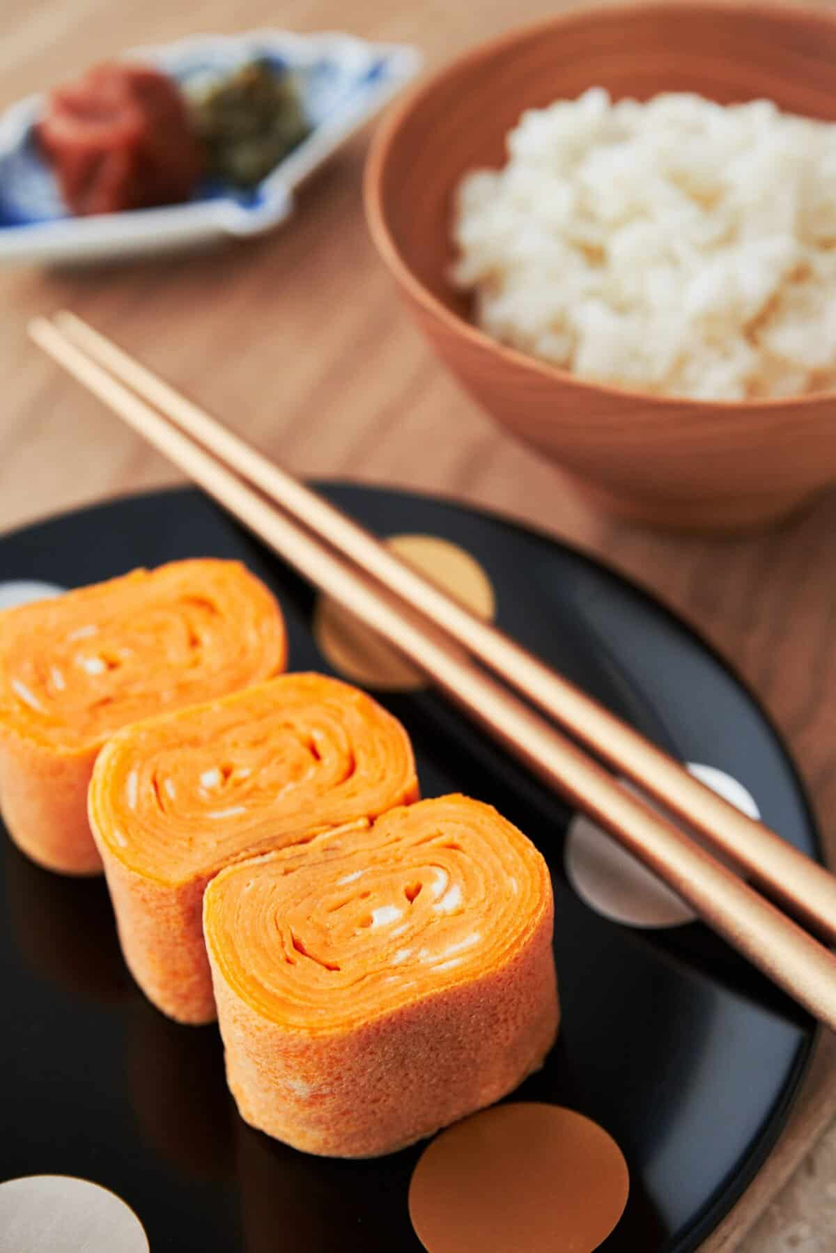 With thin layers of egg rolled into an omelette, Tamagoyaki is a delicious Japanese breakfast dish that also works great into a bento box lunch.
