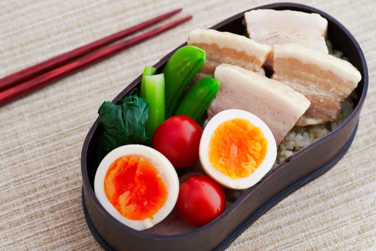 Bento lunch box with braised pork belly kakuni