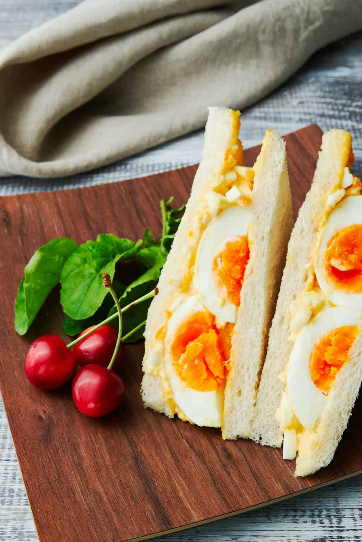 This protein packed Japanese egg salad sandwich recipe has a triple dose of eggs, packed with medium boiled eggs, egg salad, and mayonnaise.