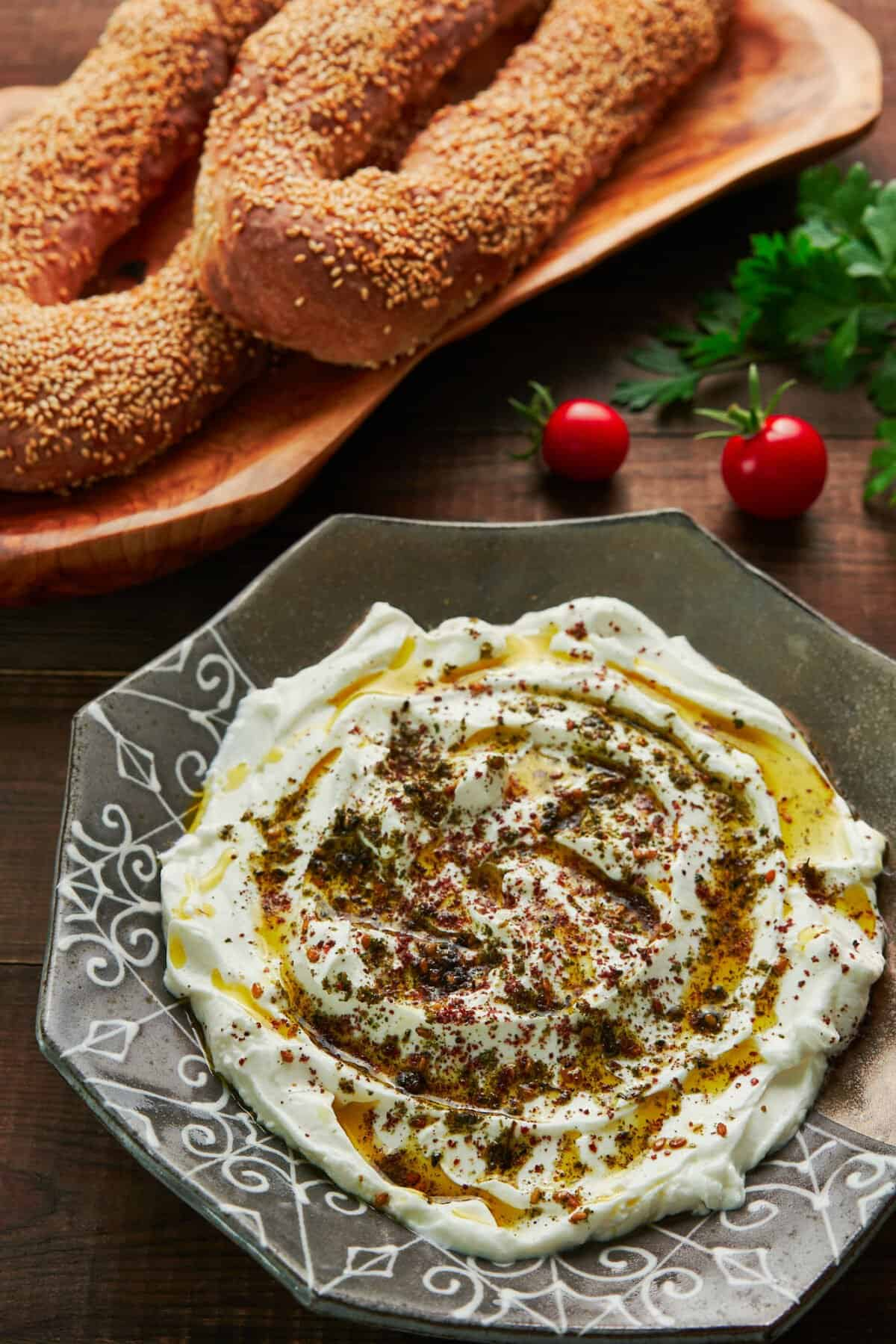 Labneh is a fresh cheese made by salting and straining yogurt, and it makes for a delicious condiment that's also great as a dip, mixed into sauces, and spread under salads. Show here with Jerusalem bagels.