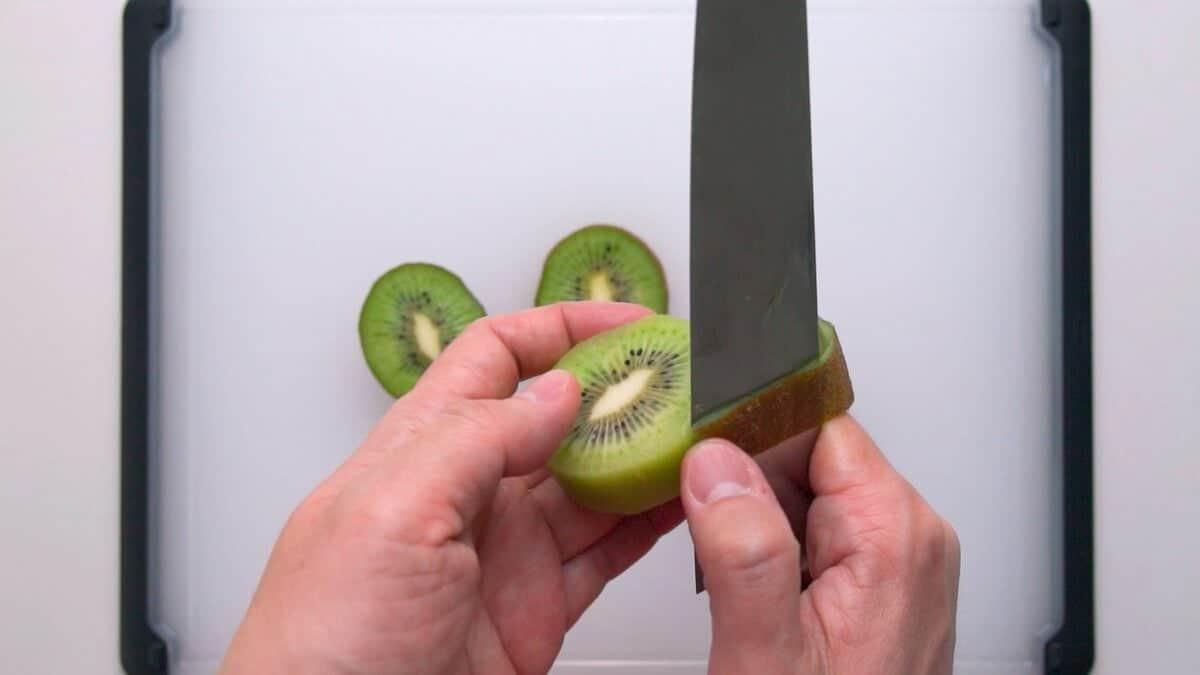 Peeling kiwifruit for fruit sandwiches.