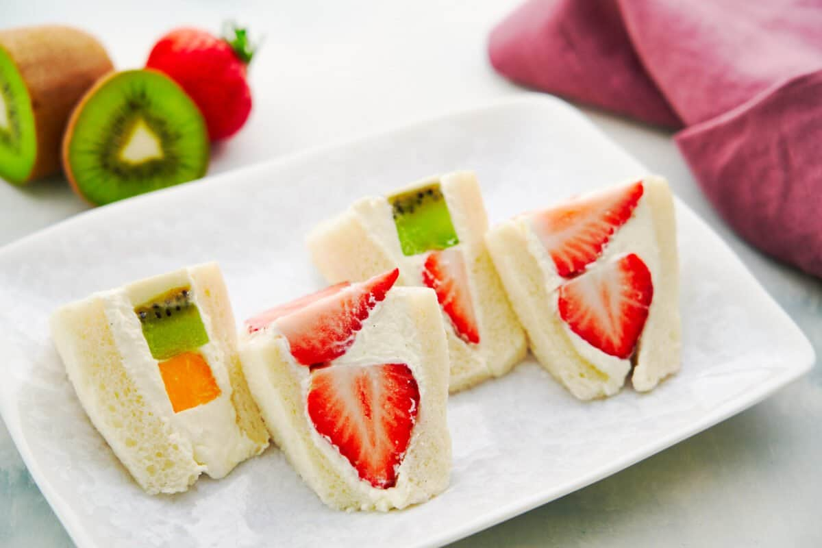 Mixed fruit sandwiches stuffed with strawberries, kiwifruit, and mango are a teatime favorite in Japan.