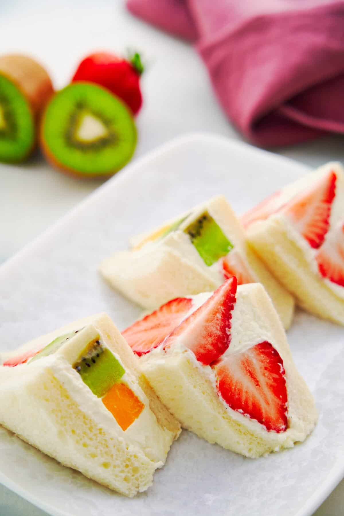Loaded with ripe fruit and vanilla-infused cream, fruit sandwiches are an easy snack or casual dessert that comes together in minutes.