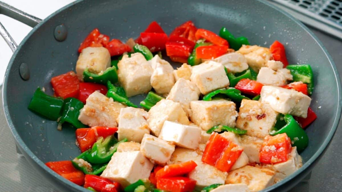 Tofu and bell peppers stir-fried before the Kung Pao Sauce goes in.