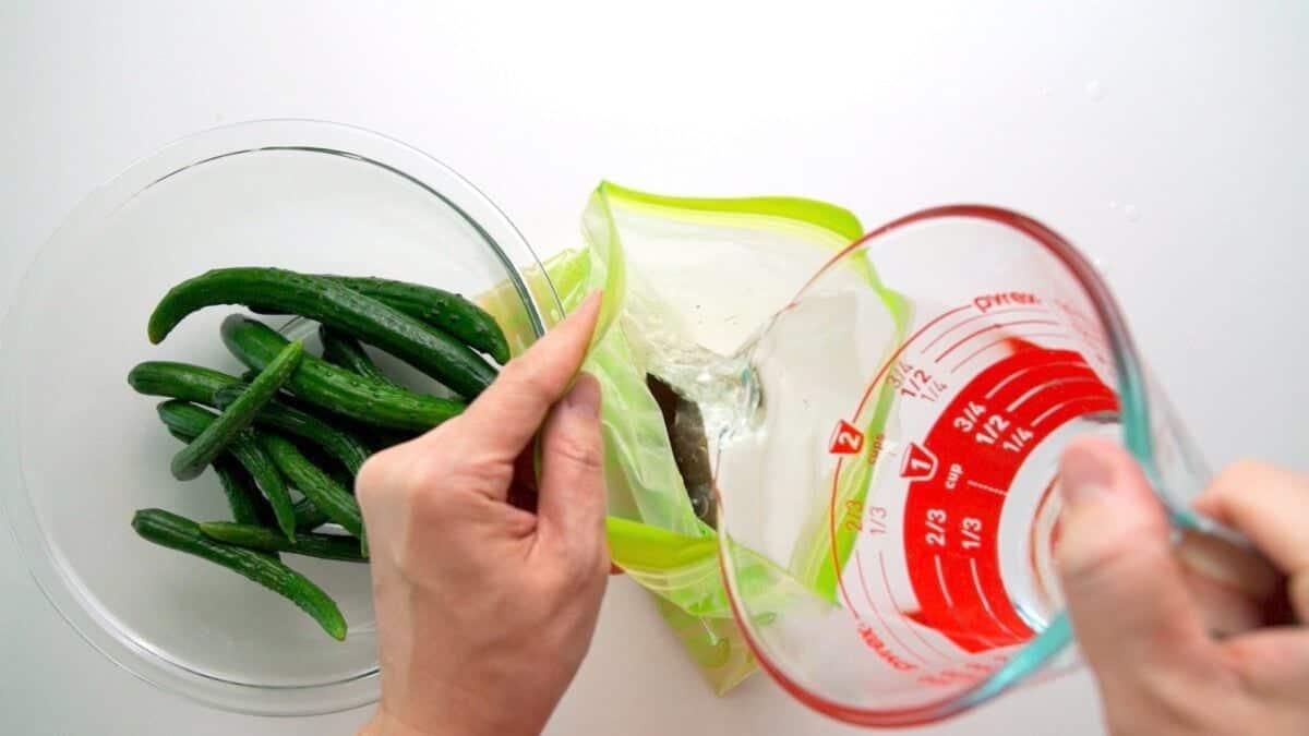 Making a salt brine to pickle Japanese cucumbers.
