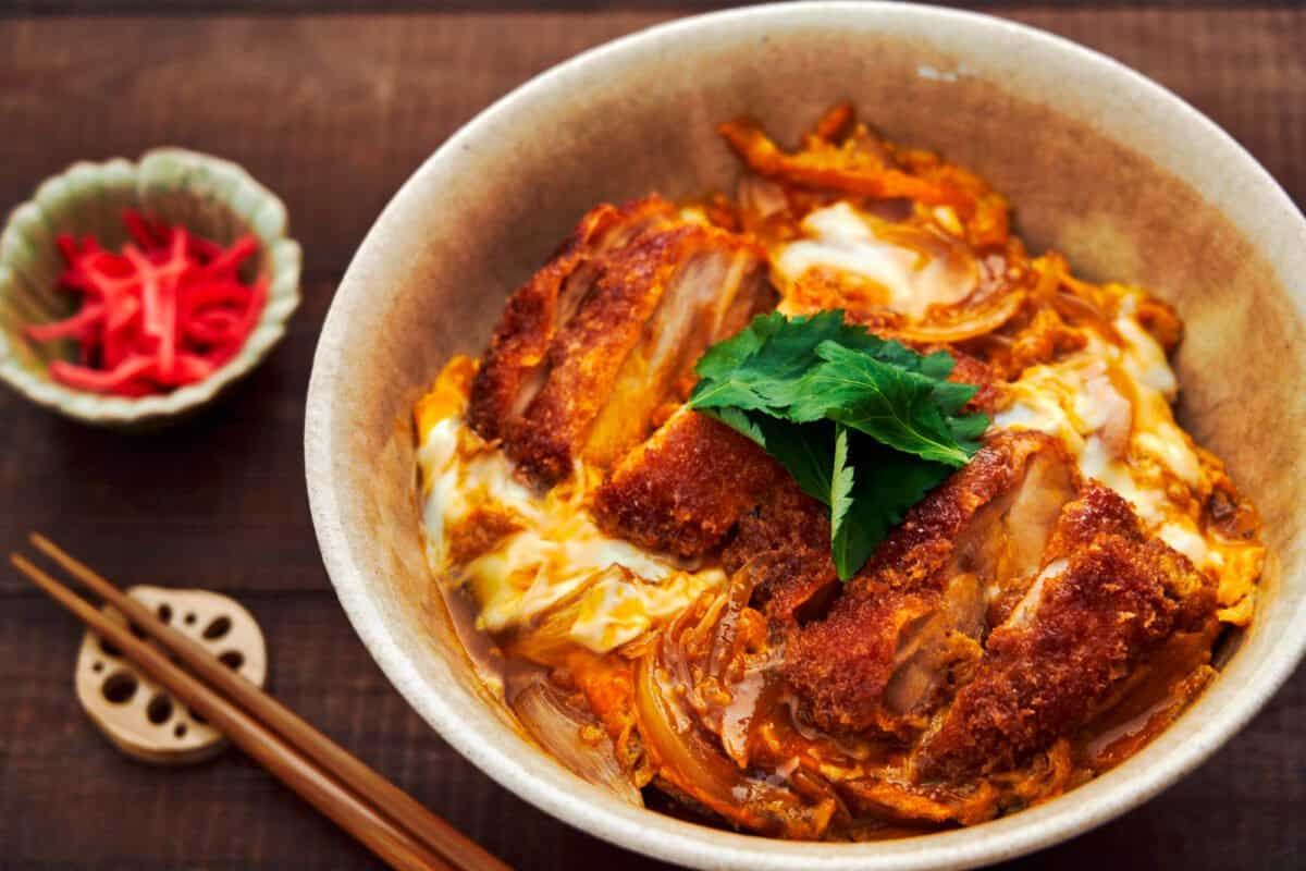 Chicken Katsudon is a mouthwatering rice bowl covered with a juicy chicken cutlet simmered with onions and egg in a savory-sweet broth.