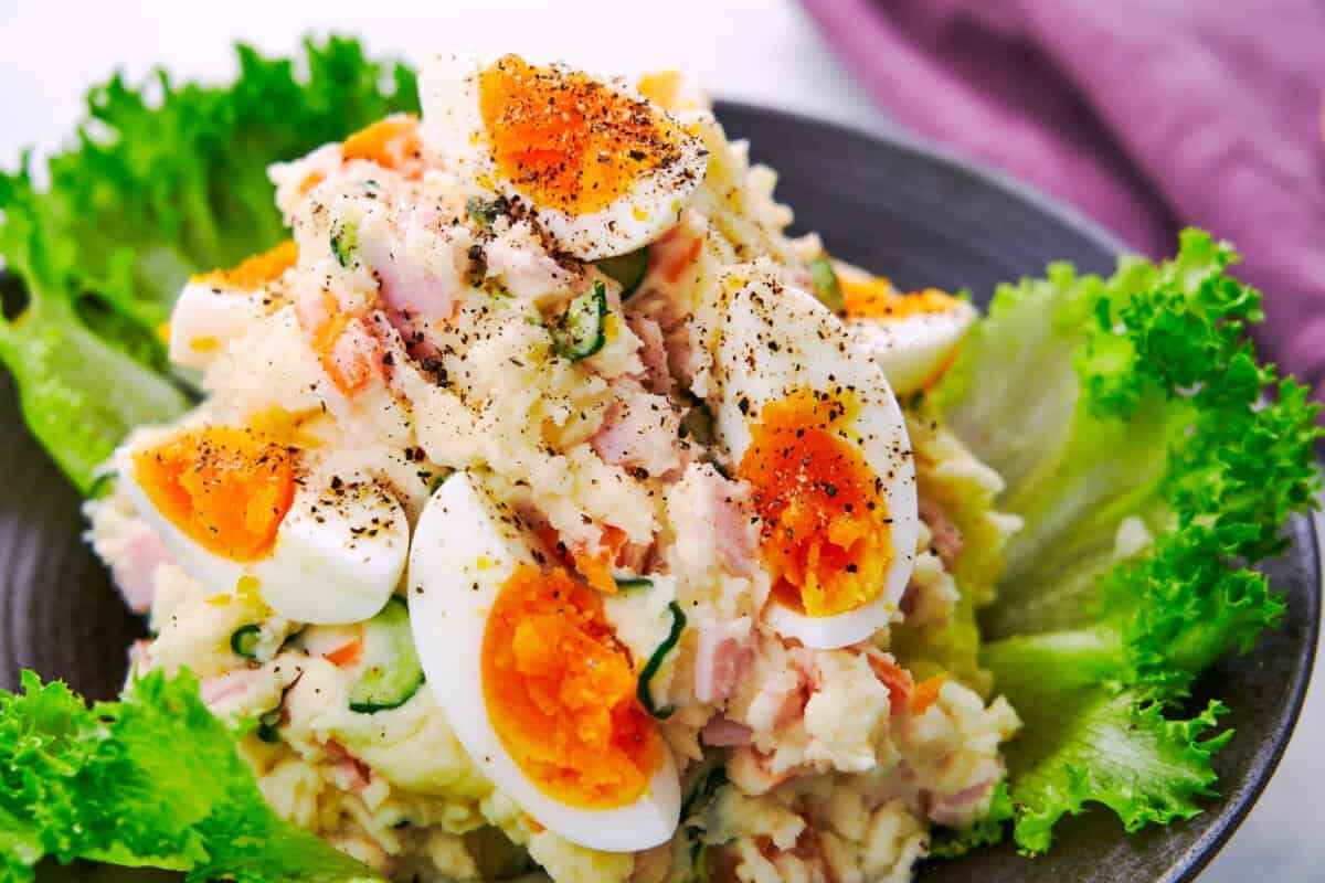 Japanese potato salad with boil eggs, ham, cucumbers, carrots, and onions.