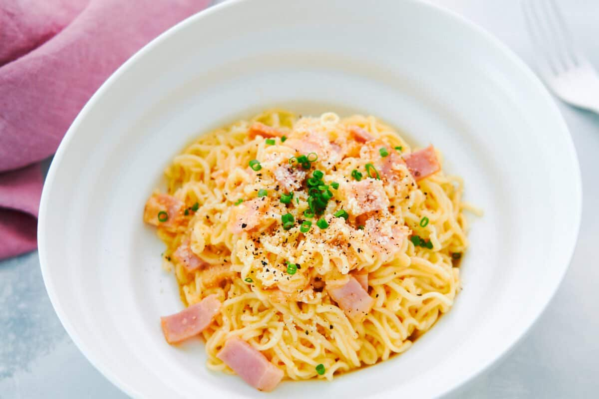 Ramen Carbonara made from instant noodles egg, bacon, and cheese.