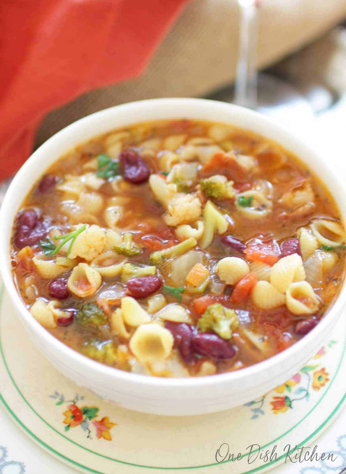 An overhead view of a bowl of minestrone soup
