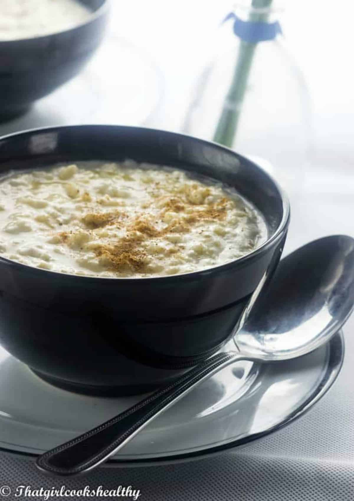 porridge in a black bowl on a plate