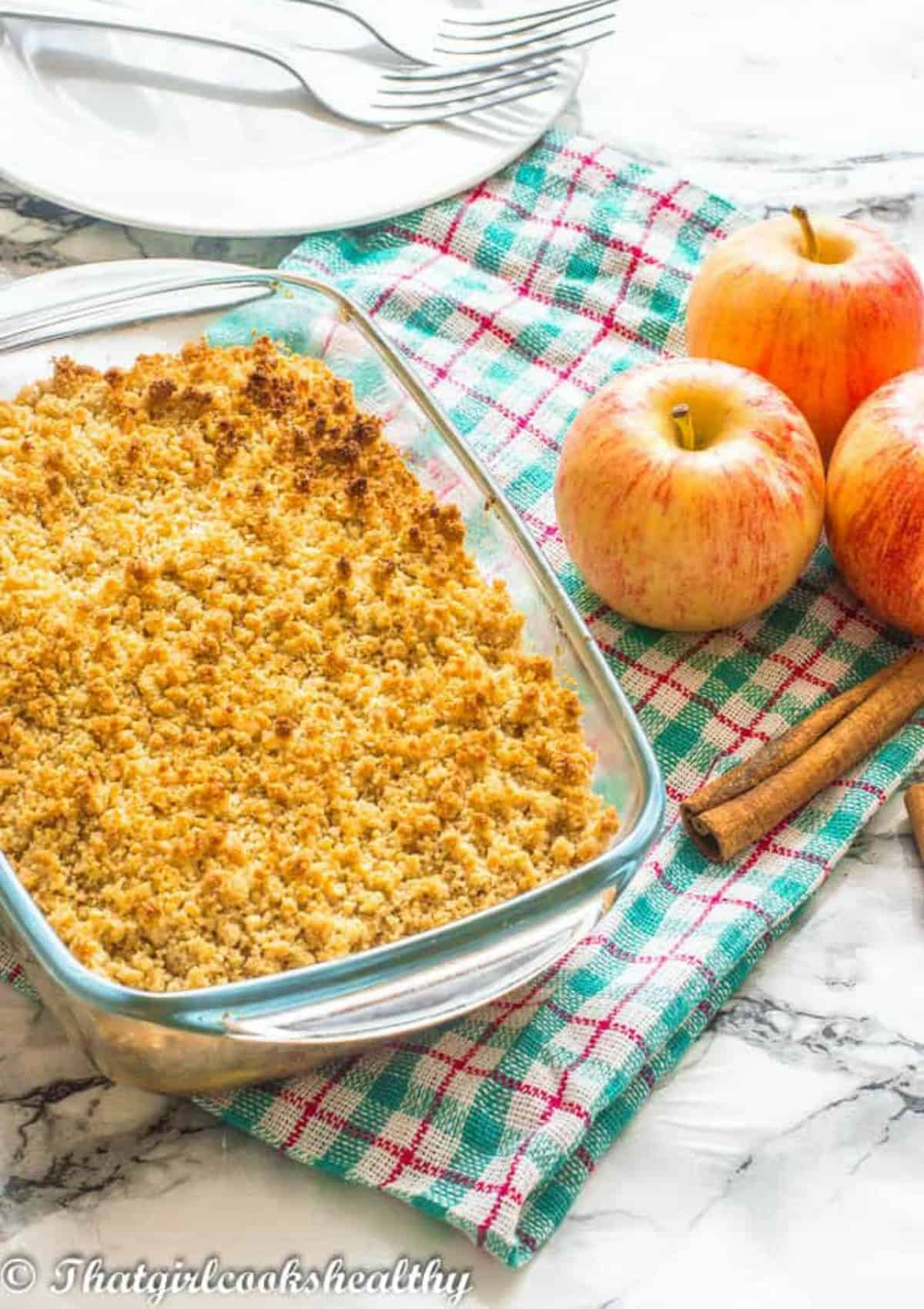 apple crisp with red apples on a cloth