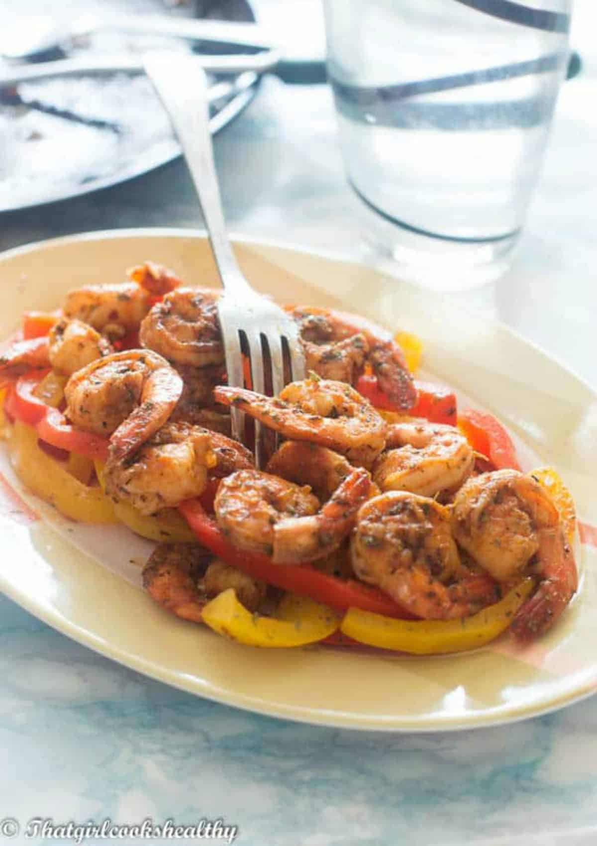 shrimp on a plate with water