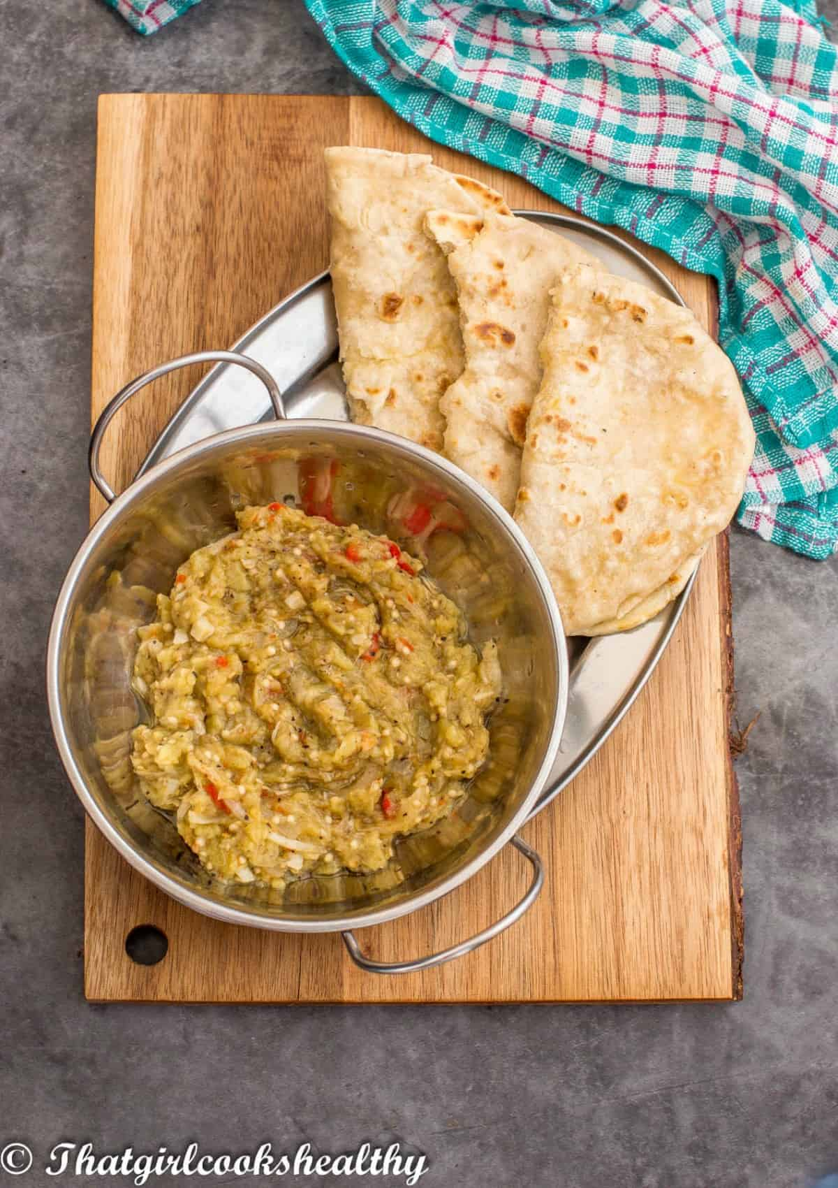 egg plant dip in bowl with roti